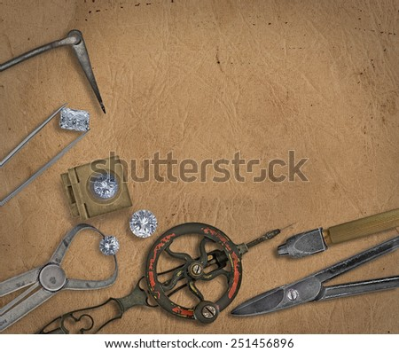 vintage jeweler tools and diamonds over  working bench, blank space for your text - stock photo