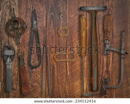 vintage jeweler tools  over wooden working wall, space for text and name - stock photo