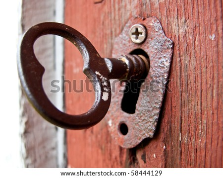 Vintage key and keyhole - stock photo