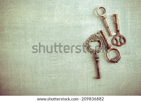 Vintage keys over painted surface - stock photo
