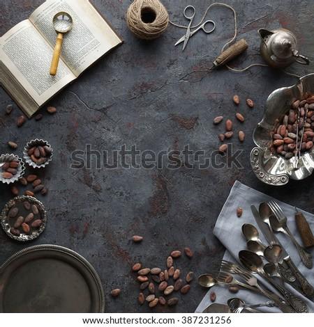 Vintage kitchen items on dark stone background, top view - stock photo