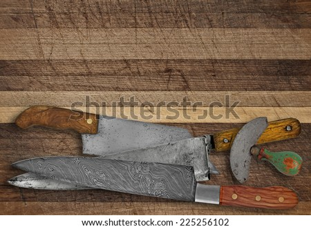 vintage kitchen knives over cutting board, space for your text - stock photo