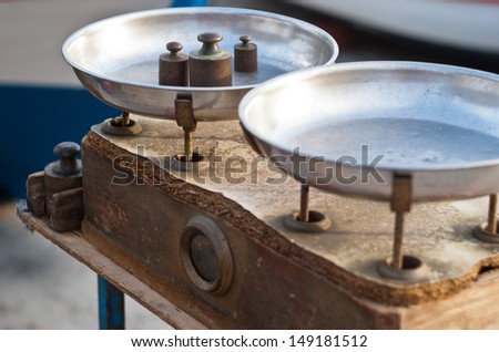 Vintage kitchen scales with brass weights - stock photo