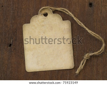 vintage label on the wooden background - stock photo