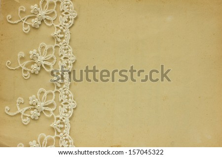 Vintage lace on the old paper - stock photo