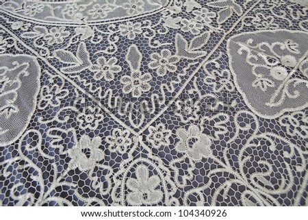 vintage lace tablecloth detail - stock photo