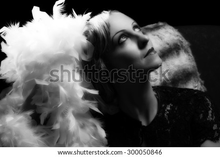 Vintage lady posing with authentic hollywood lighting - stock photo