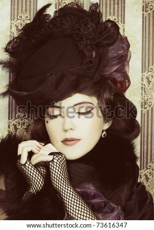 Vintage lady.Young pretty woman in black hat and furs. - stock photo