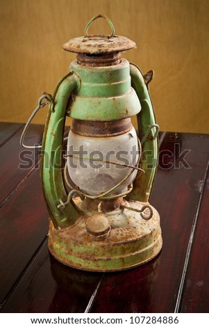 Vintage lamp isolated on wood table background - stock photo