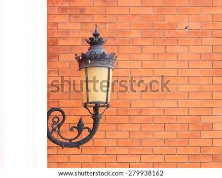 vintage lamp wall with brick wall background - stock photo