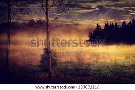 Vintage landscape. Antique style photo with foggy lake and forest. - stock photo