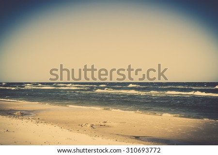 Vintage landscape with sea view, sandy beach and summer blue sky, Leba, Baltic Sea, Poland, nature backgrounds. - stock photo