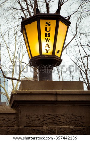 Vintage Lantern style light outside New York City subway entrance - stock photo
