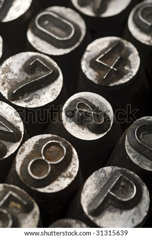 vintage lead letters typeset - shallow depth of field, focus on '&'