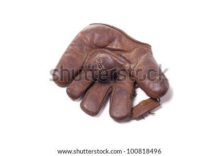 Vintage leather baseball glove with ball - stock photo
