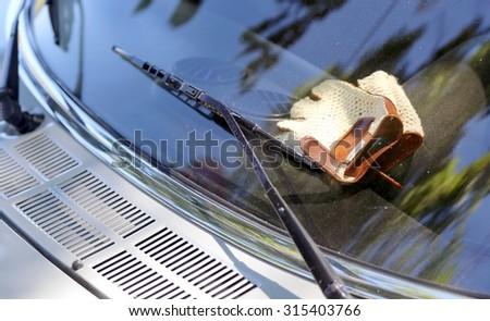 Vintage leather gloves over to vintage car dashboard - stock photo