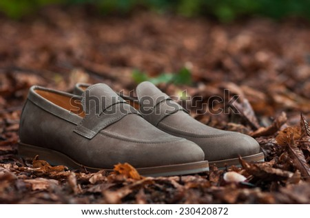 Vintage leather shoes in autumn forest - stock photo