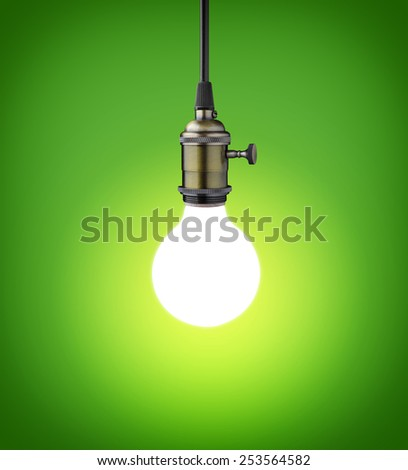 Vintage light bulb on green background - stock photo