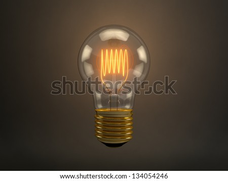 Vintage light bulb with glowing filament over dark brown background - stock photo