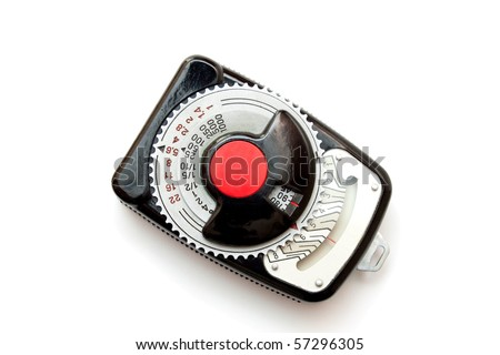 Vintage light meter isolated on white background.