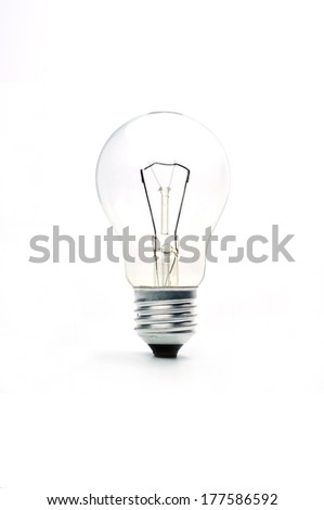 vintage lighted bulb  isolated on white background  - stock photo