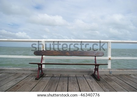 vintage looking background of old pier hervey bay - stock photo