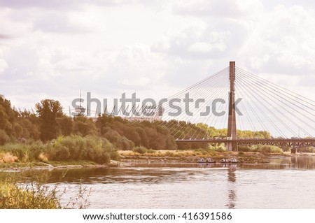 Vintage looking Bridge over Vistula river aka Wisla in Warsaw, Poland
