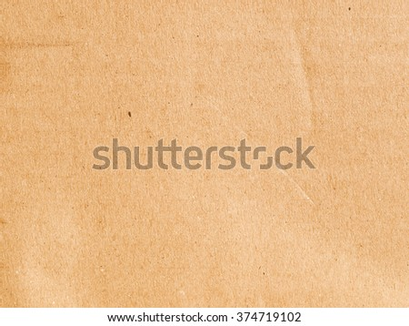 Vintage looking Brown grunge corrugated cardboard sheet useful as a background