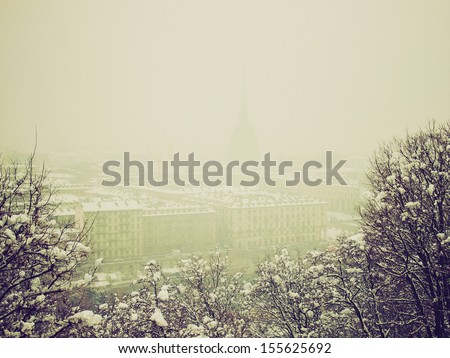 Vintage looking City of Turin (Torino) skyline panorama seen from the hill - winter view with snow - stock photo