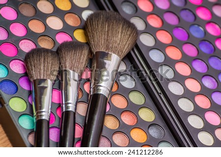 Vintage looking colorful eye shadow with professional makeup brush