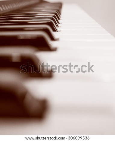 Vintage looking Detail of black and white keys on music keyboard - stock photo