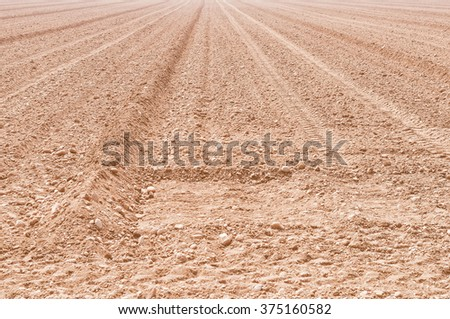 Vintage looking Earth in a field for agricultural cultivations