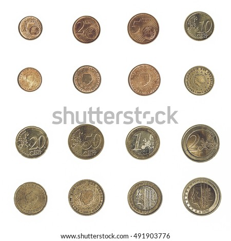 Vintage looking Euro coins including both the international and national side of Nederlands