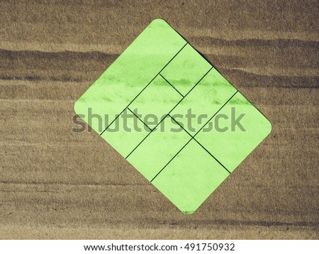 Vintage looking Green paper tag label sticker over brown corrugated cardboard box