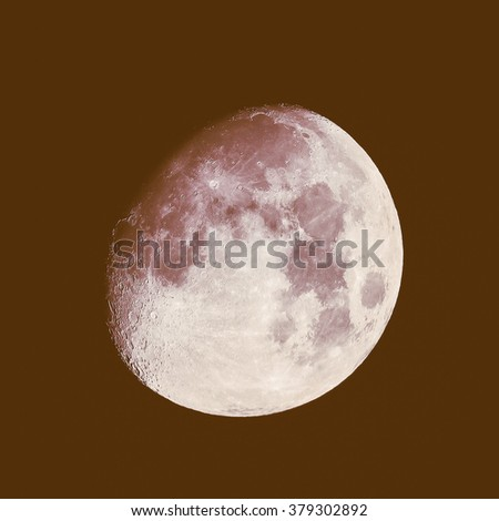 Vintage looking Moon almost full seen through a telescope image taken with my own telescope - no NASA images used - stock photo