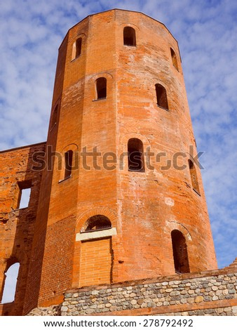 Vintage looking Palatine towers Porte Palatine ruins of ancient roman town gates in Turin
