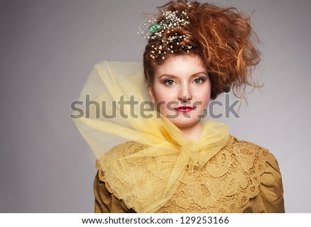 vintage looking portrait picture of young ginger woman - stock photo