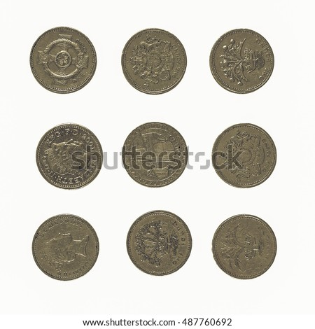 Vintage looking Pound coin (currency of the United Kingdom) - isolated over white background