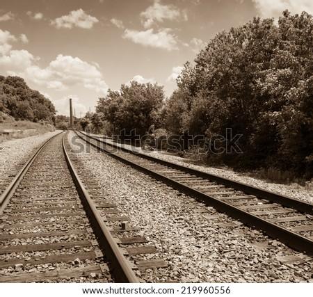 Vintage looking railroad tracks - stock photo