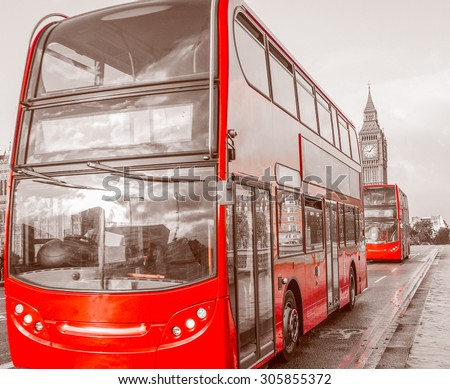 Vintage looking Red Double Decker Bus in London over desaturated black and white background