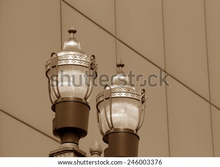 Vintage looking street lights against a solid background - stock photo