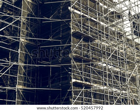 Vintage looking Temporary scaffold for construction works at building site