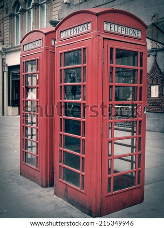 Vintage looking Traditional red telephone box in London UK