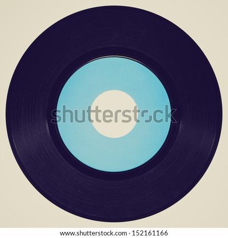Vintage looking Vinyl record vintage analog music recording medium - stock photo