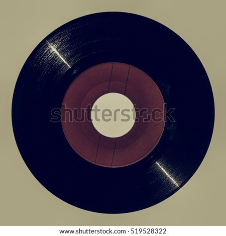 Vintage looking Vinyl record vintage analog music recording medium with red label isolated over white