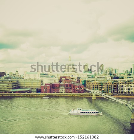 Vintage looking Wide angle view of Saint Paul's Cathedral in the City of London, UK under a typica British rainy weather - stock photo