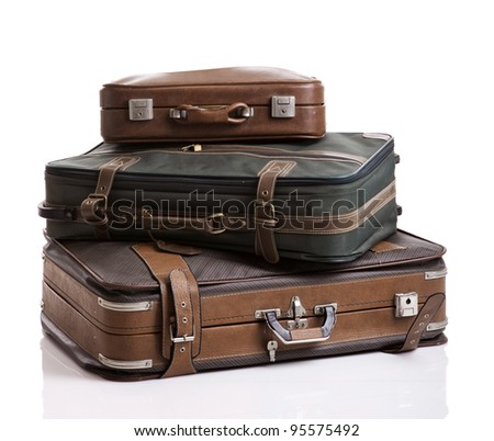 Vintage luggage, isolated over a  white background - stock photo