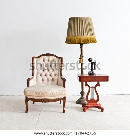 vintage luxury armchair in white room - stock photo