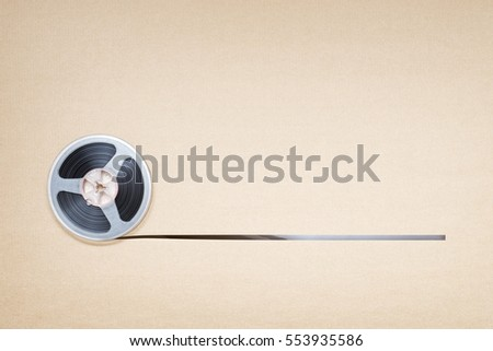 Vintage magnetic audio reel on the brown paper background