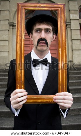 Vintage Man Thinks Outside The Square When Looking Through A Rectangular Frame